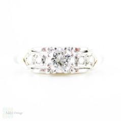 Mid 20th Century Diamond Engagement Ring, Round Brilliant Cut Diamond in Bow Style Platinum Setting. 0.31 ctw, Circa 1940s.