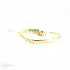Vintage 9ct Snake Bracelet, Sprung Yellow Gold Serpent Bangle with Spinel Eyes.