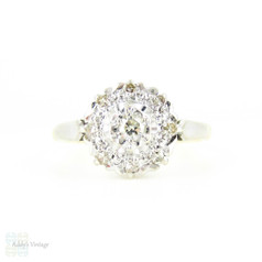 Mid Century Diamond Daisy Engagement Ring, Floral Shaped Cluster Ring. 18 Carat Gold, Circa 1940s.