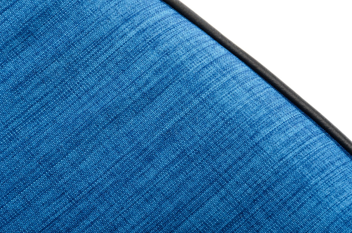 We've got a brand new blue fabric arm chair with a cool close up shot
