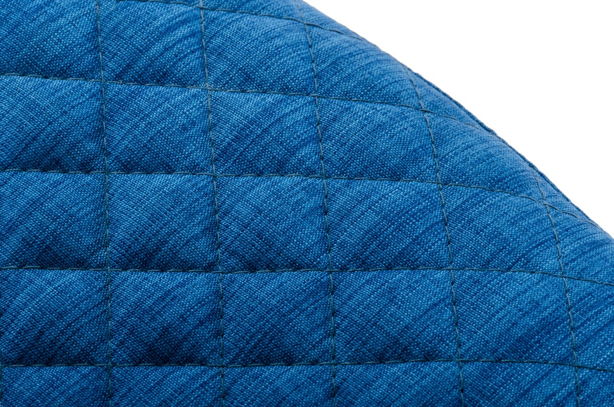 This is a close up shot of the blue fabric armchair