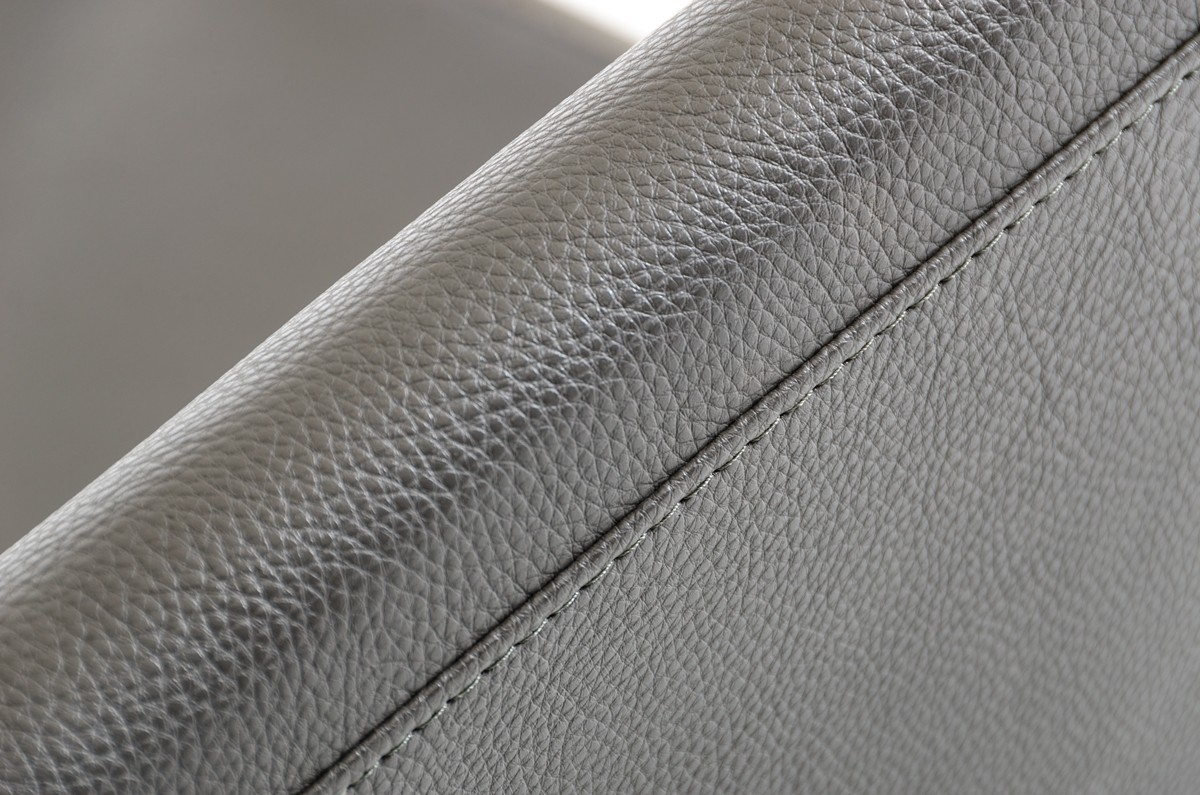 close up shot of jerry bonded leather accent chair grey