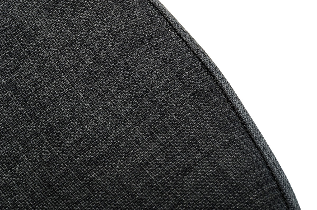 A close up shot of an gray upholstered bench called Silvino.
