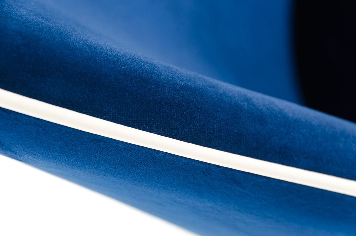 close up shot of the zephyr velvet blue dining chairs
