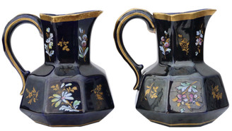 Pair of blue gilded and decorated ceramic jugs