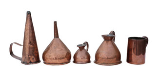 4 Victorian copper measuring jugs and funnel