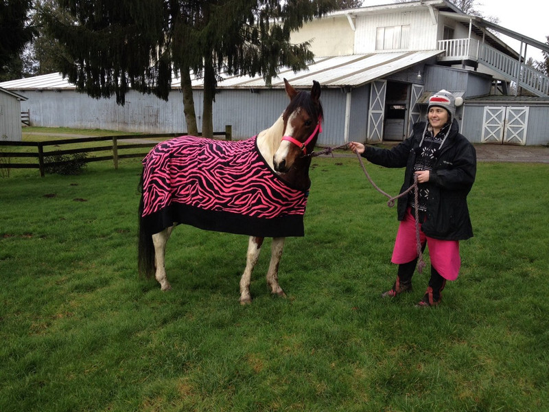Flower modeling her new pink zebra cooler Pattern is available