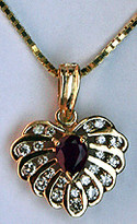 14k Yellow Gold Ruby Heart Pendant - 22 Diamonds