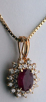 14k Ruby Pendant - 28 Diamonds weighing 1/2ct