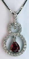 18k White Gold Circle Diamond Ruby Pendant