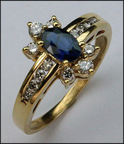 .56ct Sapphire Ring with .48ct Diamonds in Yellow Gold