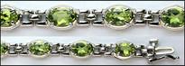 14kt White Gold & Peridot Bracelet (12 Stones)