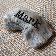 Engraved driftwood place settings and favours - your guests receive a personalised piece of driftwood to take home.
