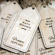 Engraved wooden luggage tag place settings and favours - your guests receive a personalised favour to take home.