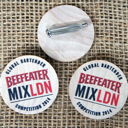 38mm round wooden badges. Printed onto wooden tokens with pin fastener.