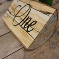 Self standing engrave table number from a rustic wood