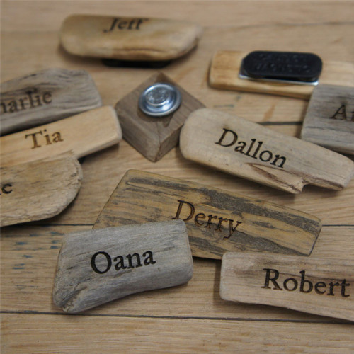 Engraved driftwood badge with magnetic attachments - each is personalised with a single name.