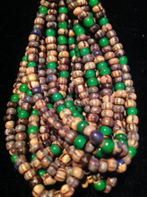 6/o Striped Picasso with Green Heart Accent Aged Seed Bead Hank