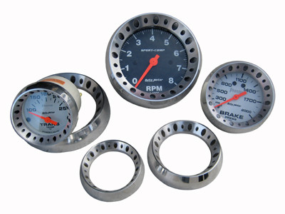 Billet drilled gauge bezels.  Gauges not included.