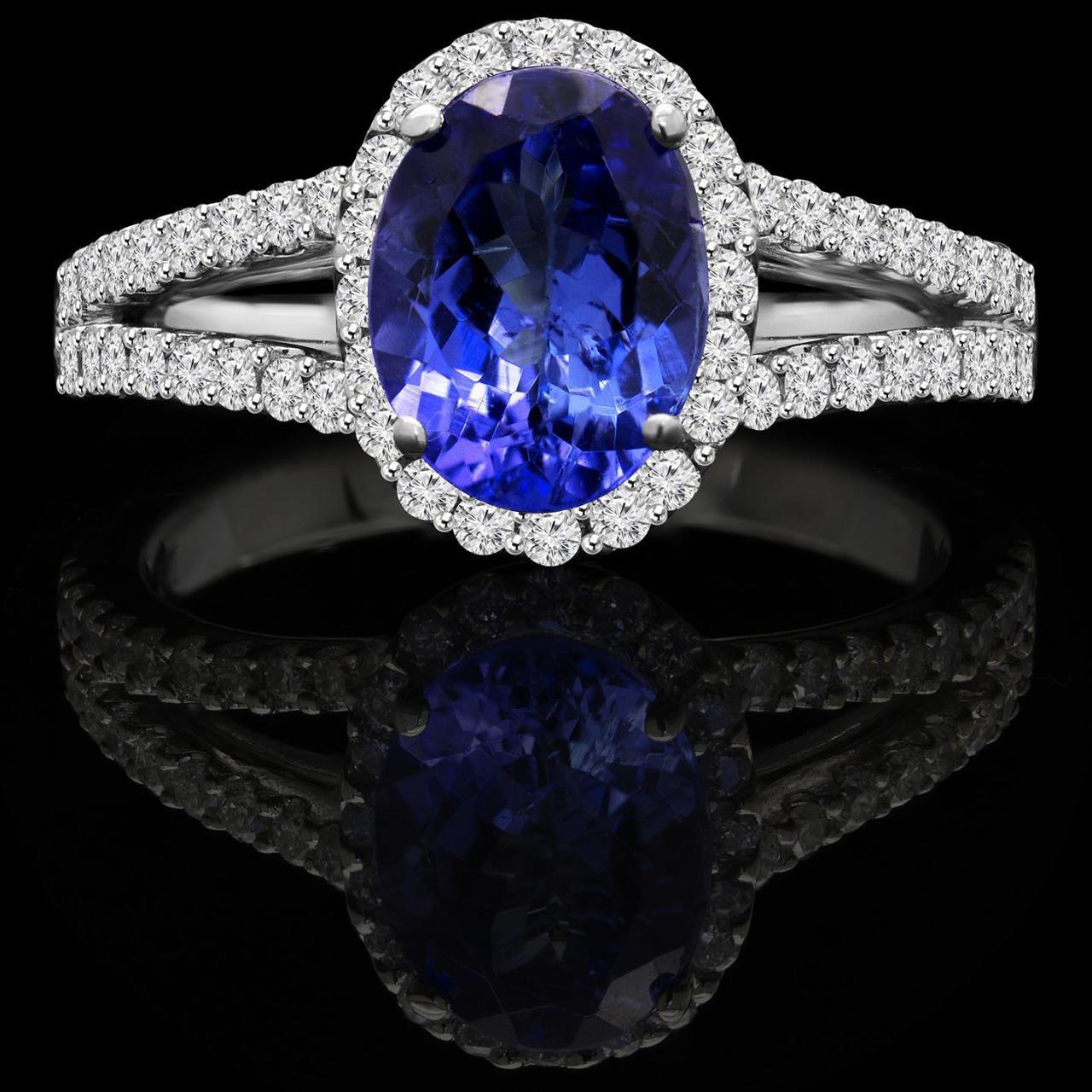 Diamond Halo Tanzanite: Oval Cut Tanzanite And Diamond Halo Cocktail Ring In White