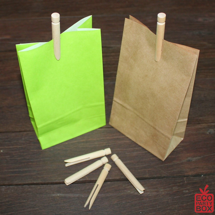 Our Mini Wooden Dolly Pegs measure 6cm high. They are perfect for securing our range of colourful paper bags.