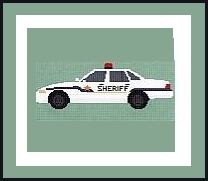 "Patrol Car Crochet Afghan Graph Pattern.  All done in single crochet, changing colors as you go along.  Drop one color, pull in the next.  Medium ability.  Size works up to be approx. 60 x 80"".  Graph is 145 stitches wide by 185 stitches high.  Then you crochet 22 rows (or more) around the outside edge including a border.  Complete instructions are included, a full size graph, and a Helpful Hints page."