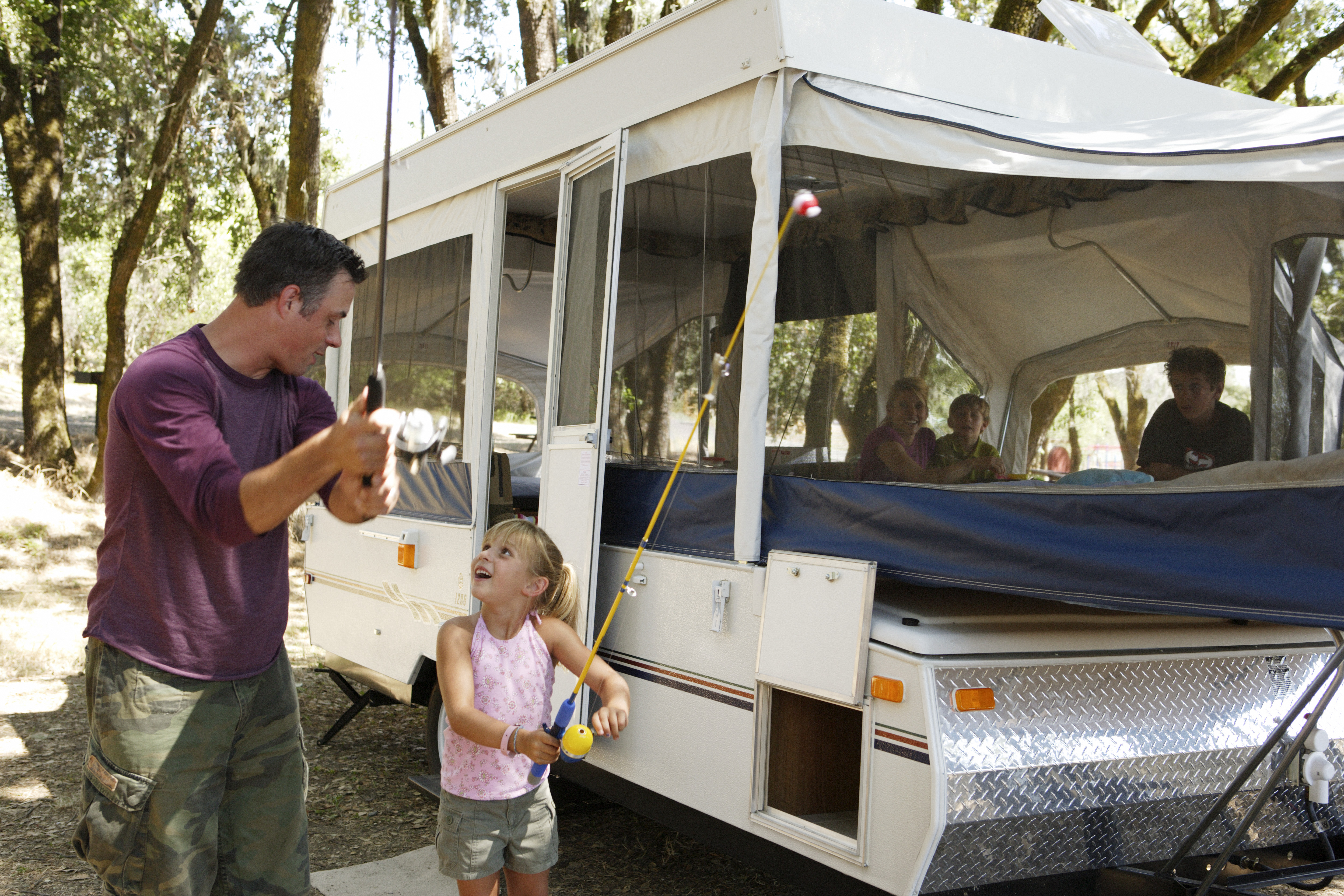 father-and-daughter-with-folding-camper-lg.jpg