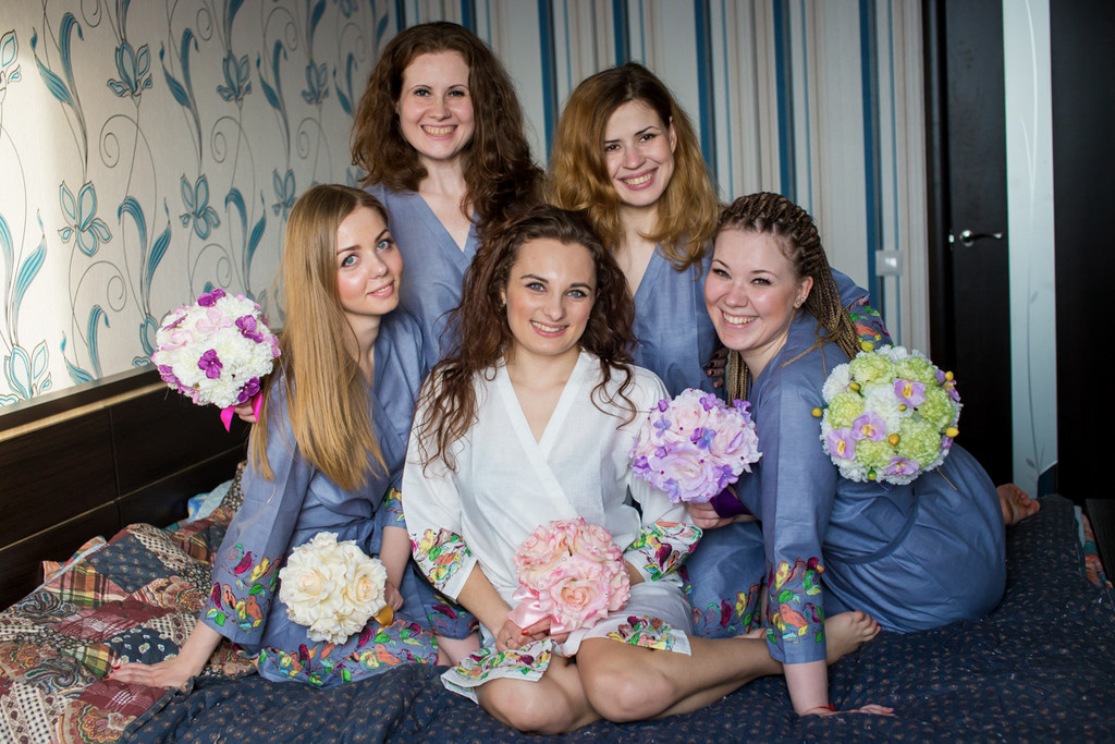 Bridesmaids in grey bird themed getting ready robes