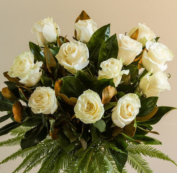 White red pink creme orange long stemmed rose bouquet with greenery