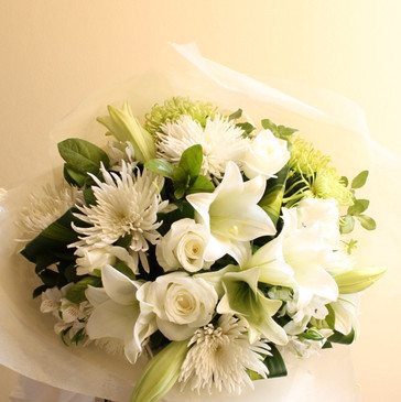 a white creme pastel pretty or bright bouquet of seasonal flowers