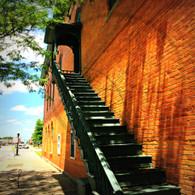 Iron Stairs Brick Wall
