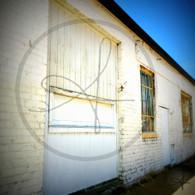 White Building Garage Door