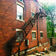 Cobblestone Alley Brick Fire Escape