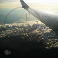 Belize Clouds and Plane Wing