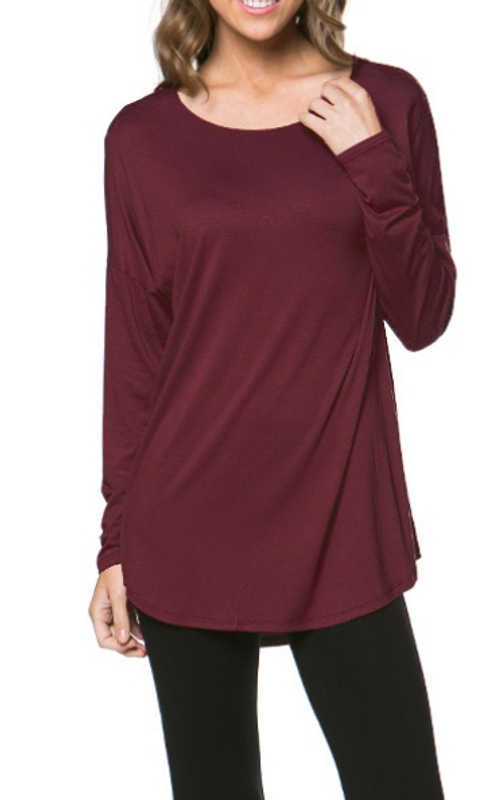 Get the straight goods with this beautifully cut scoop neck, dolman sleeve top. Simple, stylish and easy to pair with just about everything in your wardrobe. A classic top that drops from the shoulder to upper thigh with little tailoring. Can be worn loose or belted for a different look altogether!