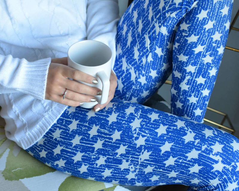 Starry starry night...stars with light trailing behind them on a bright blue legging.