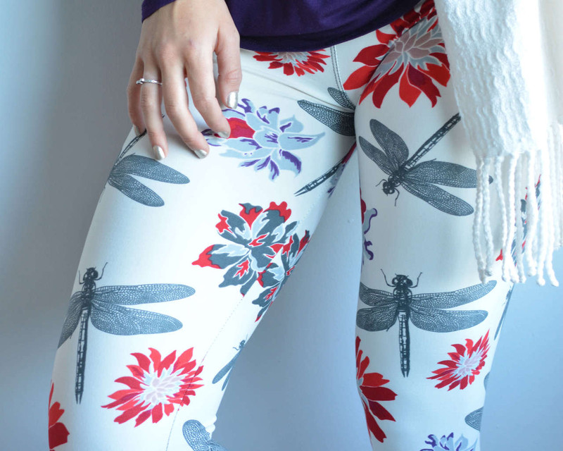 Minimalist blossoms in red, grey and purple and beautiful dragonflies on a creamy white legging.