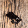 SQNK Beater Delrin includes smoked black acrylic door and opaque black button.