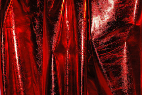 Stretch Fabric-Metallic Red Foil on Red Polyester Jersey Four way Stretch Spandex Fabric  Picture Taken Outside in Mid-Morning Sunshine