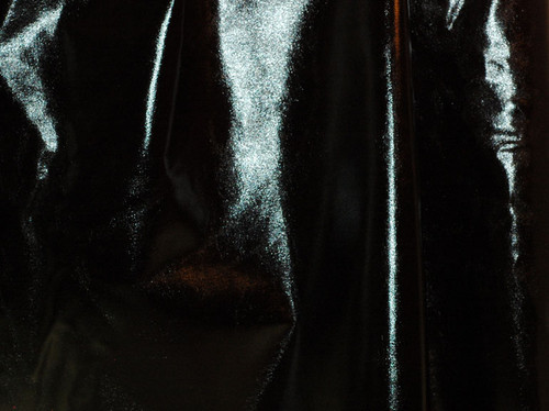 Metallic Black Foil on Black Polyester Jersey Four way Stretch Spandex Fabric by the Yard Picture Taken Outside in Mid-Morning Sunlight