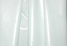 Stretch Fabric-Metallic White Foil on White Polyester Jersey Four way Stretch Spandex Fabric Picture Taken Outside in Mid-Morning Sunshine