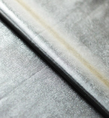 Stretch Fabric-Metallic Silver Foil on Black Polyester Jersey Four way Stretch Spandex Fabric Picture Taken Inside with Studio Lighting