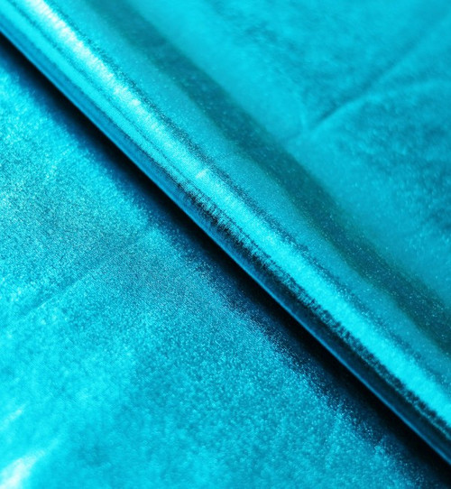 Stretch Fabric - Metallic Turquoise Foil on Turquoise Polyester Jersey Four way Stretch Spandex Fabric  Picture Taken inside Under Studio Lights