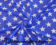 Blue and white patriotic star print see through stretch mesh fabric.  Fabric is twisted to highlight draping and lighting.