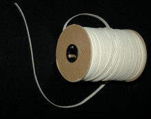 Braided Elastic - Natural Cotton Elastic on Roll with piece pulled to the side.