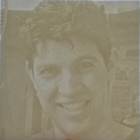Lithophane held on a canvas up to window to allow even light