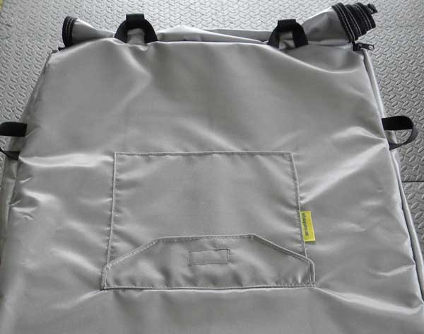 """Accessory """"pocket"""" with Velcro closure sewn into cover top."""