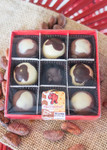 Brown Cow/Big Cheese Truffle 9 Piece box top-view with clear lid
