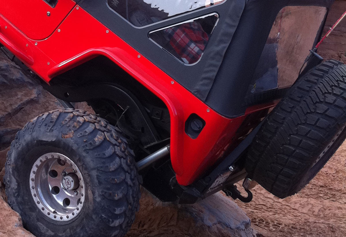 Genright's reshaped bezel allows for a full rear flare & factory filler neck and cap