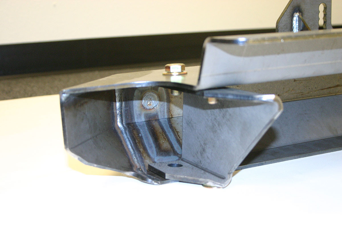 Here you can see how the bracket adapts a YJ front bumper to fit a CJ frame